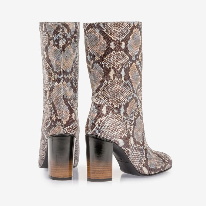 Brown and white leather boots with snake print