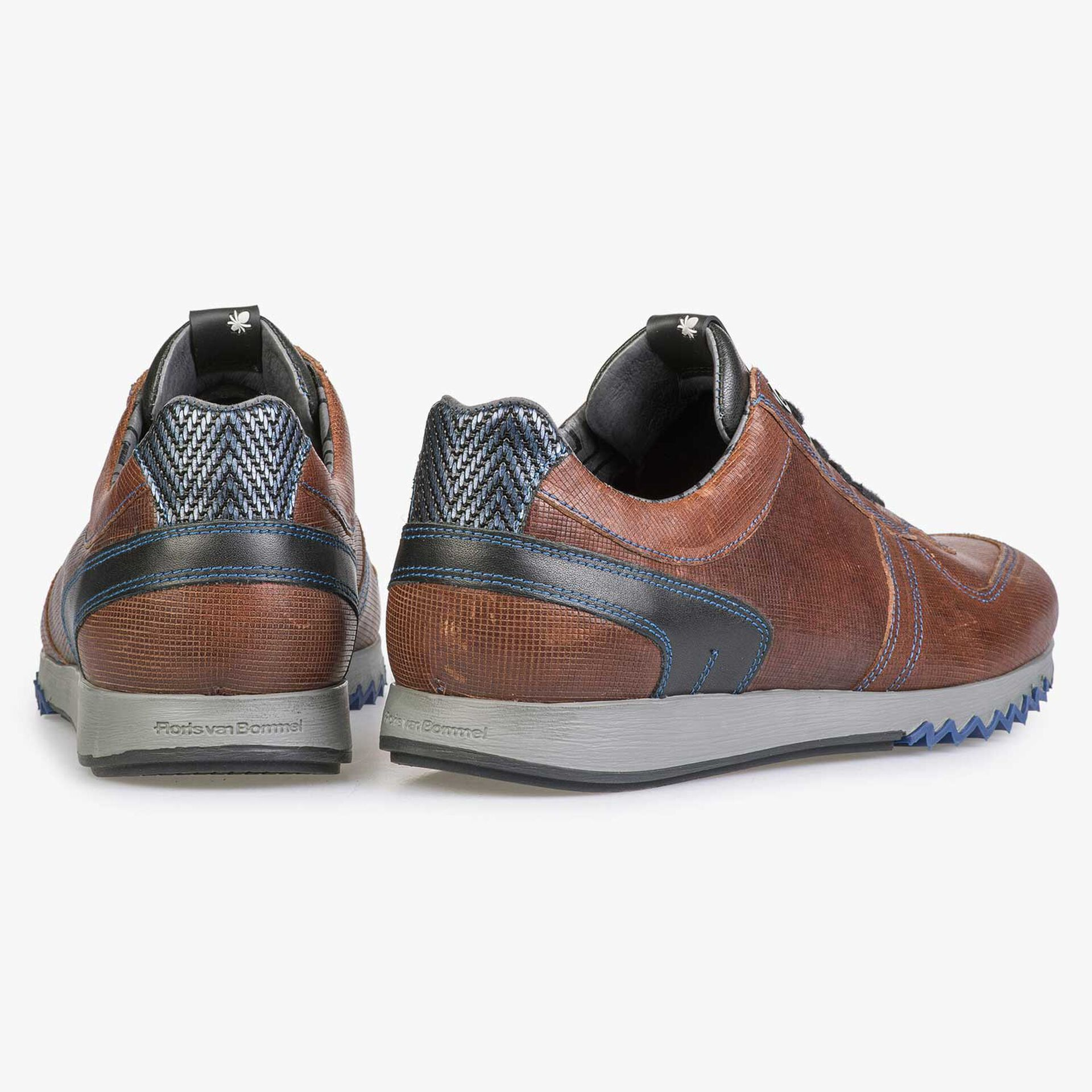 Brown sneaker with cobalt blue stitching