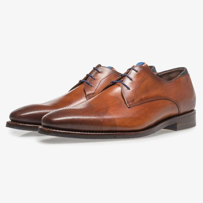 Dark cognac-coloured calf leather lace shoe with laser-cut pattern