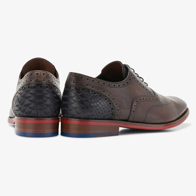 Leather lace shoe with a red sole
