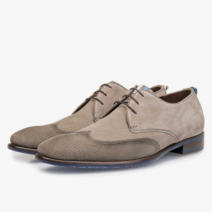 Taupe-coloured calf suede leather lace shoe with a laser-cut pattern