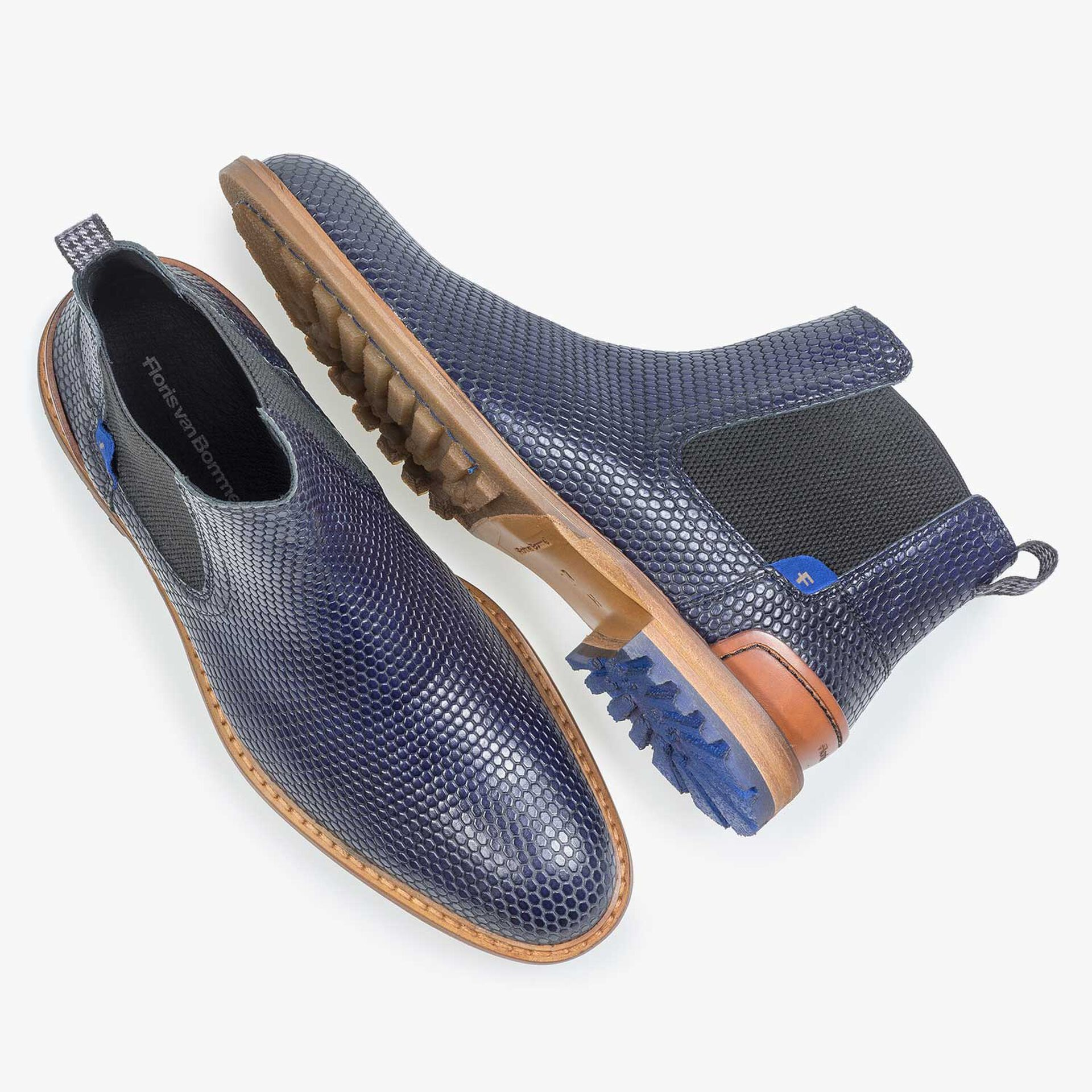 Dark blue leather chelsea boot with a structural print
