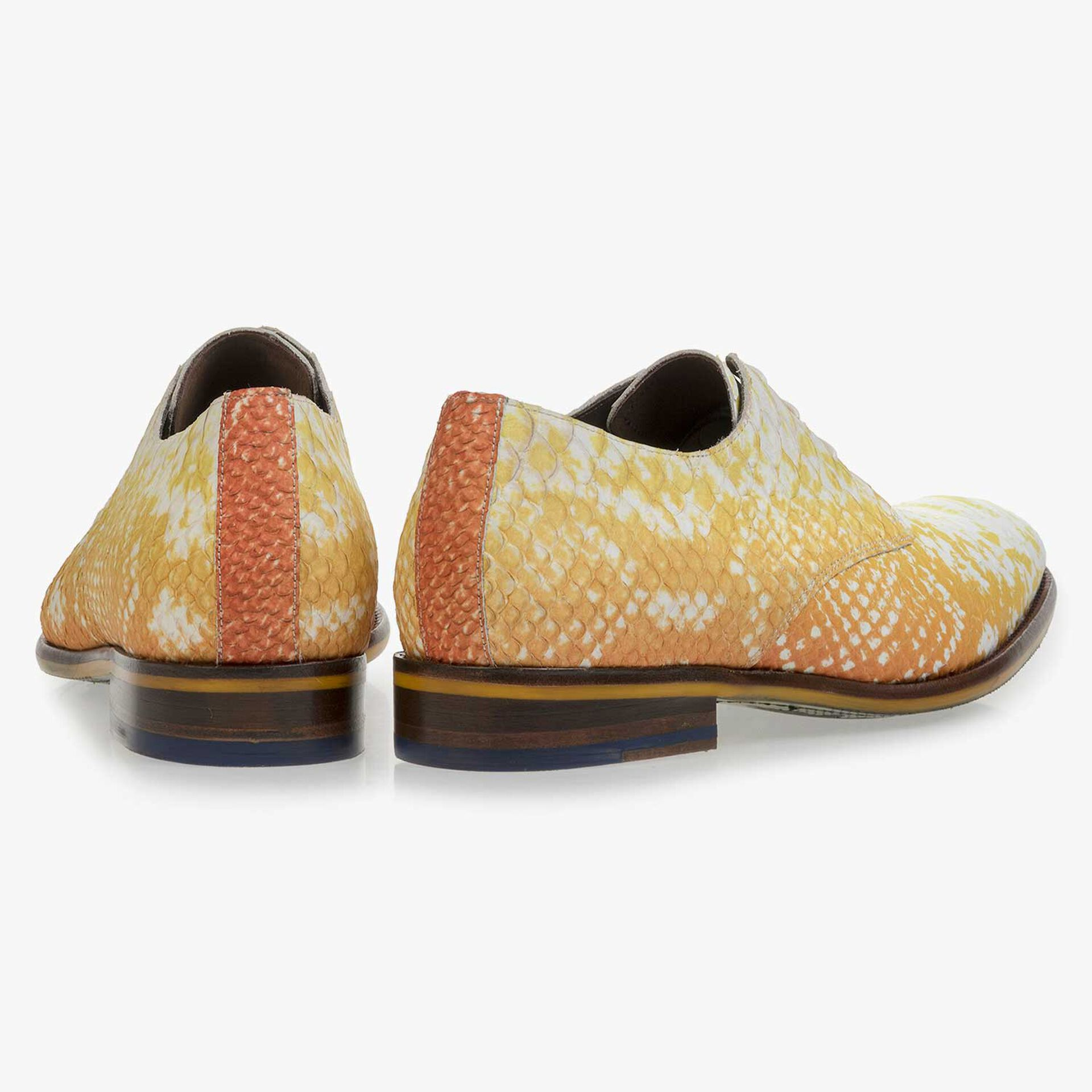 Yellow leather lace-shoe with snake-print