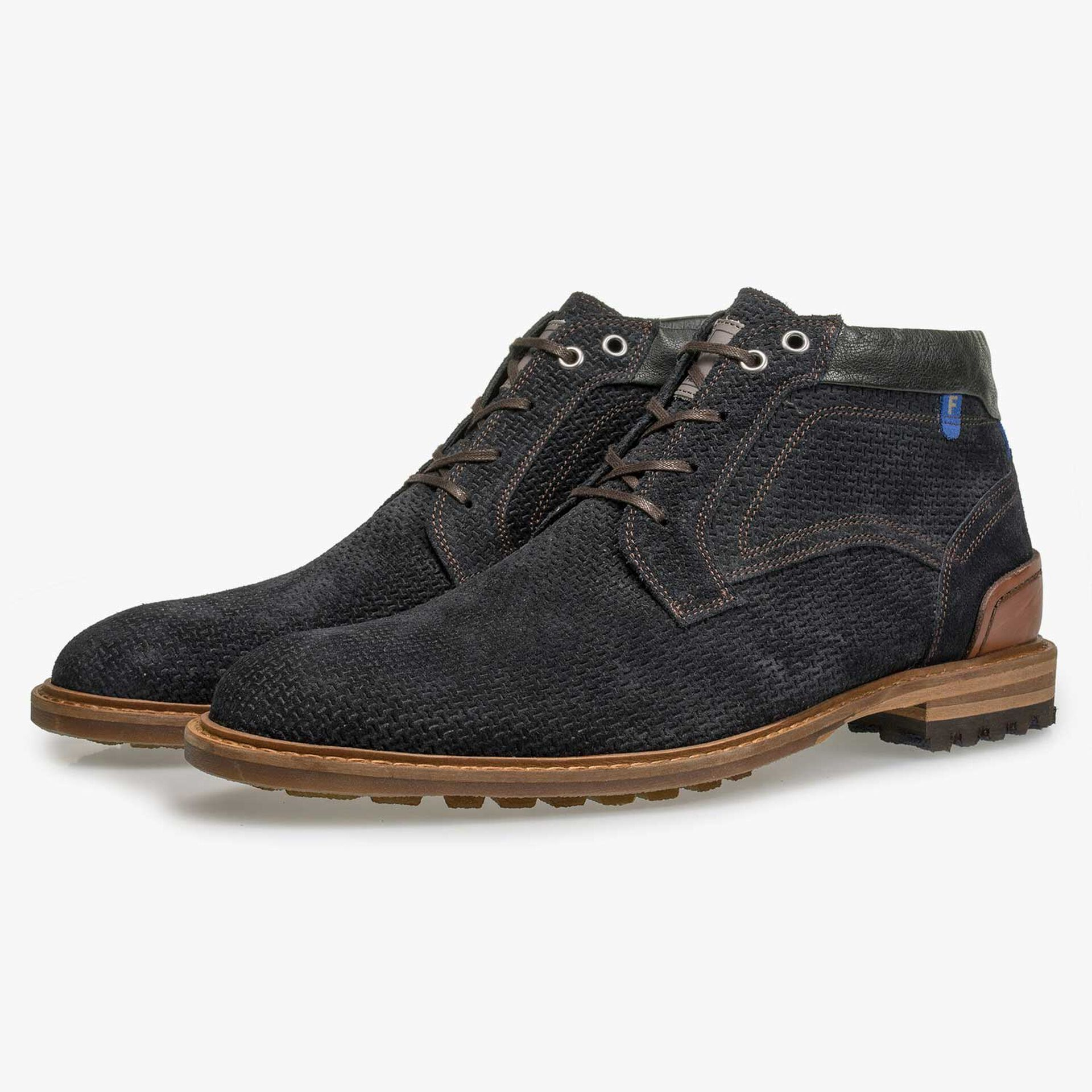 Dark blue suede leather lace boot with structural pattern