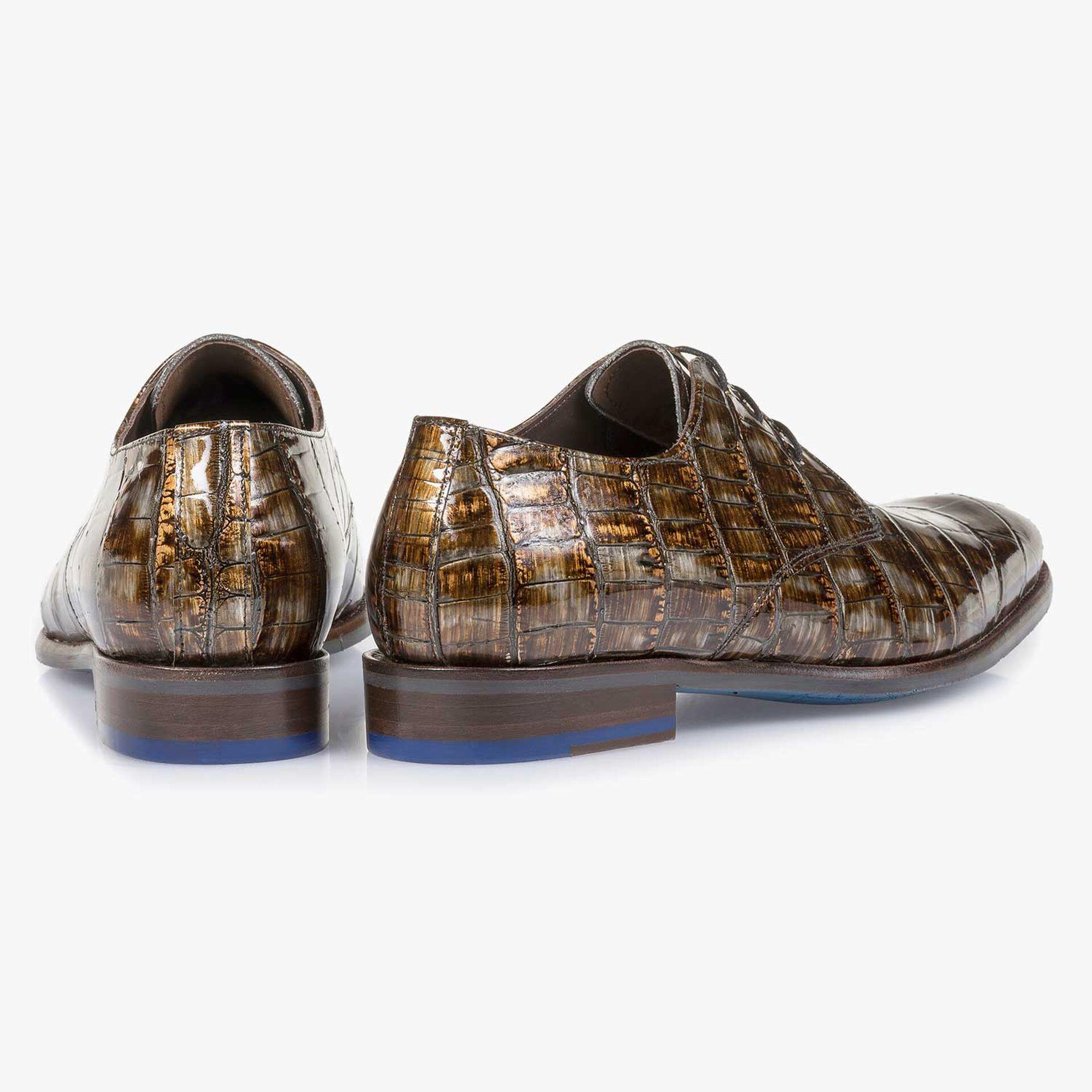 Cognac-coloured lace shoe with a croco print