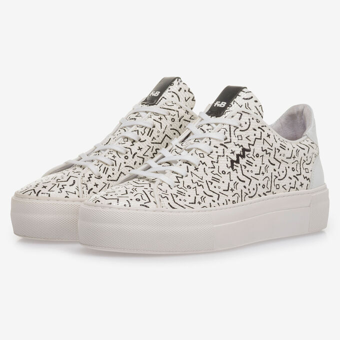 White leather sneaker with black print