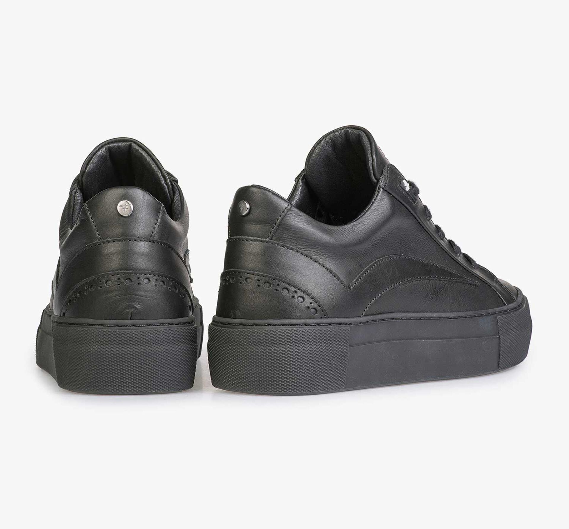 Black leather sneaker with a black cup sole