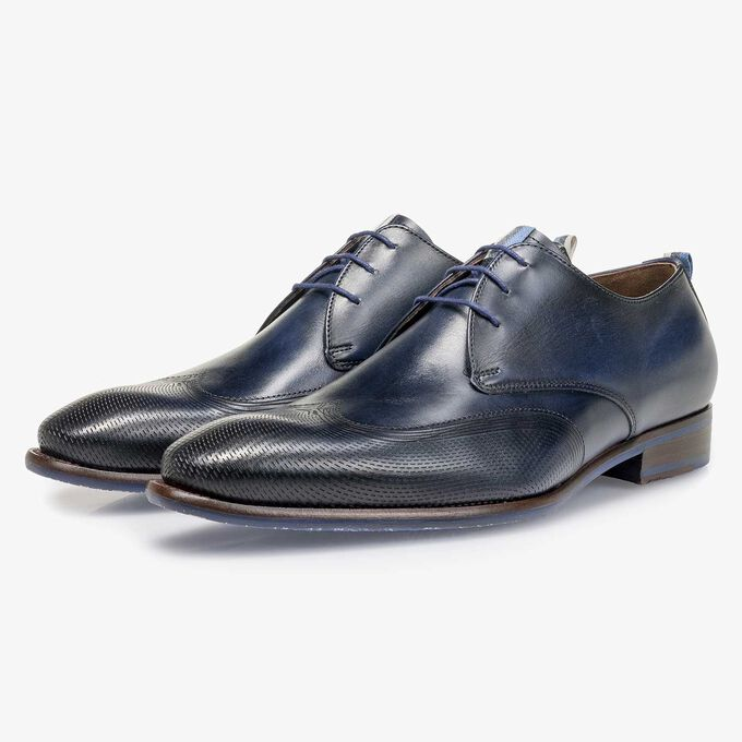 Dark blue calf leather lace shoe with a laser-cut pattern